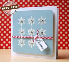 Peace  By Cristina Kowalczyk    An array of embossed snowflakes with gem centers is the basis for a fun holiday card. It's so simple it hurts