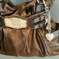 Authentic Kathy van Zeeland bag Excellent condition snap top shoulder bag three open pockets and one zipper pocket interior  two open pocket side exterior and one zipper pocket with a silver Kathy crown pull bag also has a awesome detachable key see in pic on front of bag.  Bag is bronze Kathy Van Zeeland Bags Shoulder Bags