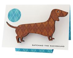 Satchmo the Dachshund - wooden brooch engraved with a retro argyle pattern