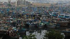 Fishing ships waiting in the harbor because of Nilofar. Karachi, Pakistan.