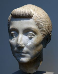 """Roman marble portrait of an older woman, dating from the first century B.C. (the Met dates the image to ca. 40-20 B.C.)   If correct, the portrait was made in the last decades of the Roman Republic -- or at the very beginning of Augustus's reign. The hairstyle is similar to that worn by the wife of Augustus, Livia (note the prominent """"nodus"""" over the forehead, in fact a broad braid).  Metropolitan Museum of Art, inv. 2000.38. Compare to National Museum, Rome inv. 124493."""