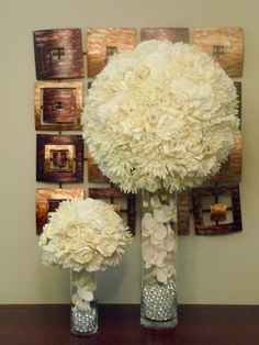 .Maybe the smaller one or a size in between...with pearls, red roses & white carnations...