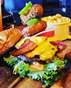 """""""Live life on the edge."""" They say... Why not. 🍔🍔🧀🥓🌶#hoptinger #burger #roulette #life #edge #beer #bemaifoodie"""