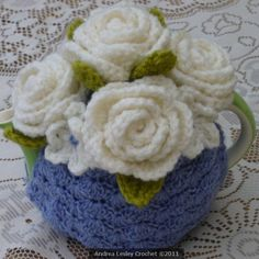 #Crochet tea cozy in lilac with #roses. No pattern and no longer available for purchase. Pinned for inspiration where to put all the flowers that I have crocheted :).  #afs 21/5/13
