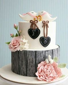 Wedding cake with wood board effect and chalk board hearts, sugar flowers and love bird toppers