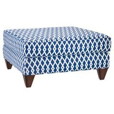 "Cocktail ottoman with an ultramarine trellis motif and exposed legs.   Product: Cocktail ottomanConstruction Material: Wood and fabricColor: Ultramarine and white Features: Square tapered legsTrellis motif Dimensions: 17"" H x 31.5"" W x 31.5"" DNote: Some assembly required"