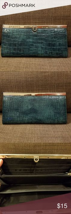 Teal and Gold clutch style wallet Gorgeous teal snakeskin print clutch style wallet.  I don't know the brand (no tags). Card sleeves and a zippered pocket. Bags Wallets