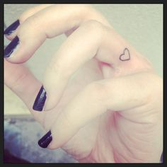Little heart tattooed on the finger where the heart veins go through / wedding ring finger