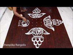 Rangoli is an artistic creation with rice flour that is made outside the front entrance of the house It is usually done by the women flok of the house early . Rangoli Designs Peacock, Small Rangoli Design, Rangoli Patterns, Rangoli Kolam Designs, Rangoli Designs With Dots, Rangoli Designs Images, Rangoli With Dots, Beautiful Rangoli Designs, Simple Rangoli