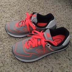 New Balance 574's Neon Orange/Light Grey/Black/White. Worn only once, great condition. Extremely comfortable. $20 OBO. New Balance Shoes Sneakers
