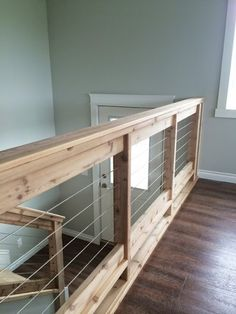 Owner Building a Home: Stainless Steel Cable and Wood Railing