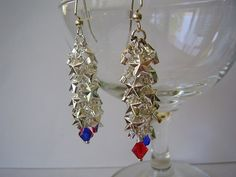 Red and blue Swarovski crystals dangle from a chain of silver stars. The earrings are mounted onto silver steel French hook ear wires for comfortable wearing and include a complementary pair of rubber