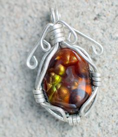 Fine Gemstone fire agate pendant Total size, 36x23x7 mm. Total weight 6.2 grams