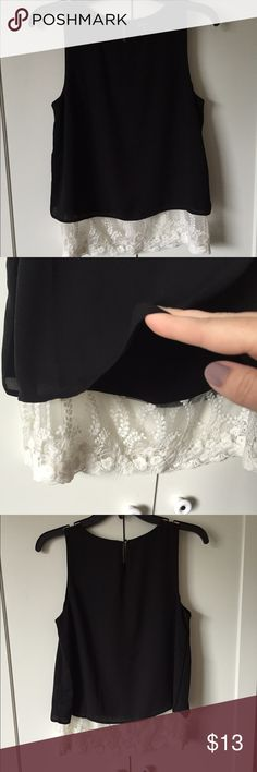 Black top with white lace details on the bottom Cute top. Black with white lace details on the bottom. Size s Monteau Tops