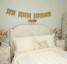 Perfect for your guest room decor! This burlap banner is on a thin twine with mini clothes pins. It is not glued to the twine, so the clothes pins are