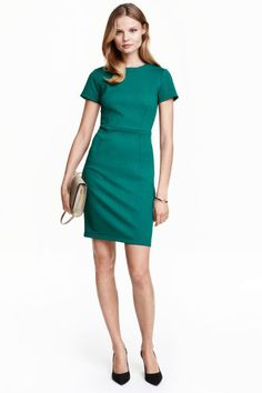Textured dress: Fitted dress in textured jersey with short sleeves, a seam at the waist and a visible zip at the back. Unlined.