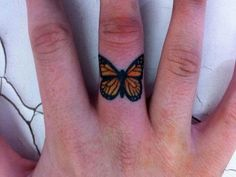 Orange+Butterfly+on+Middle+Finger+Tattoo                                                                                                                                                                                 More