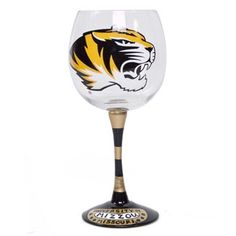 This boldly decorated wine glass will compliment any occasion. The tiger head logo is directly on the glass with a black and gold striped theme on the stem of the glass. Don't miss out on this unique opportunity to show your tiger spirit.