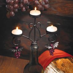 This Wine Bottle Candelabra is a wine bottle candle holder that fits in the neck of a standard wine bottle and uses tealights to turn your empty wine bottle into a beautiful candelabra. This wine bottle candelabra will bring warm, glowing light and charm to any setting.