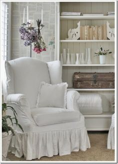 White sitting room with book page wall - oh so french shabby chic!