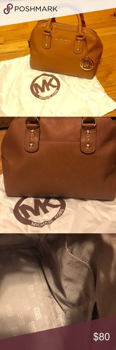 """MICHAEL KORS Jet Set Travel Satchel Luggage Pre used with minor spots of discoloration shown in photos. Made of Saffiano leather in the luggage/acorn color. Top zip closure. Handles with 4"""" drop. Interior features 2 side pockets, 1 zip pocket. Approx 10""""W x 8""""H x 6""""D. Protective feet at bottom. Michael Kors Bags Satchels"""