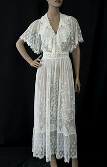 Irish crochet/embroidered tulle tea dress, c.1912. The deeply cut    armholes and full sleeves are quite comfortable. The pattern on the skirt features high relief, padded    satin stitch embroidery. The floral pattern confers on the dress the winsome beauty    it had when first worn to a garden party 90 years ago.