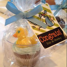 Baby shower rubber duck cupcakes make as favors for guests to take home. Rubber ducks from oriental trade.