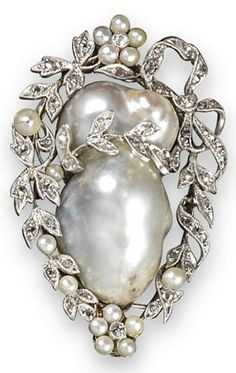 cool An early 20th century pearl and diamond brooch. The baroque pearl set within a s... #pins #DiamondBrooches