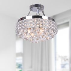 Add a modern and classy style to your indoor decor with this semi-flush mount chandelier with a contemporary design from The Lighting Store. This four-light chandelier has a chrome finish to easily bl