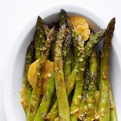 To make BHG's Roasted Asparagus-Orange Salad, toss Asparagus spears in a tangy orange-fennel seed dressing after they've been removed from the oven. #yum