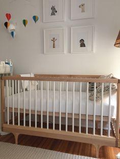 Kalon caravan crib, Flensted balloon mobile, the Animal Print Shop prints, Número 74 pillows, Serena & Lily rope rug.