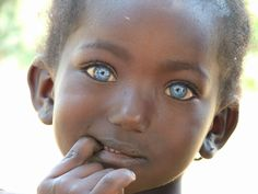 Little girl with natural blue eyes