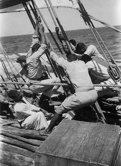 Sailors working on a deck covered in mangrove poles, Alan Villiers, 1938