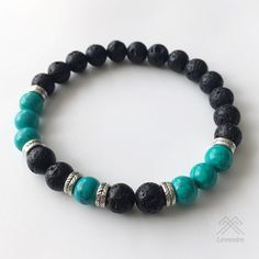 Stretch bracelet made from semi-precious 8mm Lava Stone beads, Hubei Turquoise beads, and Antique Silver spacer beads strung on the high-quality elastic stretch for long-lasting durable fit. Turquoise Beads are undyed, stabilized, rich green blue with black veins. The bracelet comes