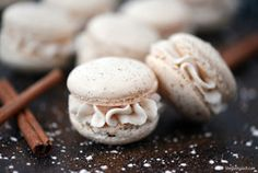 Eggnog Macarons are a light, airy Christmas cookie with the delicious taste of n. Eggnog Macarons are a light, airy Christmas cookie with the delicious taste of nutmeg and cinnamon. They are filled with eggnog buttercream frosting! Köstliche Desserts, Delicious Desserts, Dessert Recipes, Plated Desserts, Holiday Baking, Christmas Baking, Macarons Christmas, Christmas Macaron Recipe, Edible Christmas Gifts