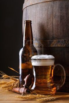 Still life with beer mug, bottle, grain and wooden barrel Stock Photo