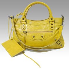 Balenciaga...I have this bag & am obsessed with it! LOVE the yellow!