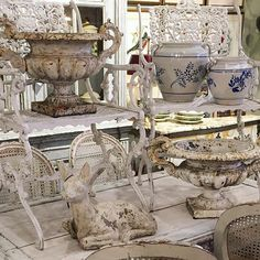Shop shot.  Pair of white iron garden chairs, cast stone deer, blue and white confit pots from southern France and a killer pair of iron urns. #frenchantiques #frenchpottery #antiquekitchen #antiqueconfitpots #antiqueurns #urn #vintagegarden #urnes #atlantaantiques #white #caststone #deer #gardendecor #foxgloveantiques #mamaisonantiques