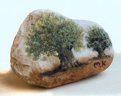 Original miniature oil paintings of olive trees on the pebbles of the Jordan River and the Sea of Galilee.