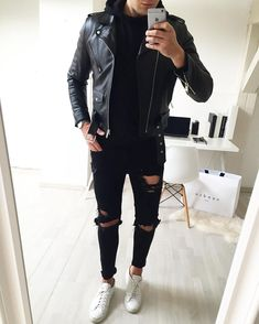 Leather jacket and black ripped jeans