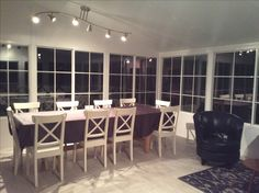 The floor tile is grey and white extra large tiles   Extra large table and chairs purchased separately at IKEA