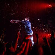 Macklemore shares his bottle of water with the crowd during a performance at Emens. #muncie #macklemore #macklemoreandryanlewis #ballstate #concert #music #rap #dance #fly #thriftshop #perform #celebrity #song #light #bsu #hydrate - Jordan Kartholl