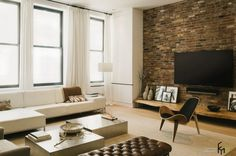 A Brown Natural Brick Idea For Modern Living Room With White Low Sofa And Astounding Home Decor Plus Flat TV Awesome Loft House Design with Exposed Brick Wall Interior in Unique Beauty Plan Interior Design, Home design