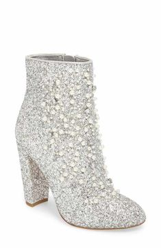 Polished beads and twinkly crystals add sparkly dimension to a statement glitter bootie lifted by a half-moon block heel. Crazy Shoes, Me Too Shoes, High Heel Boots, Shoe Boots, High Heels, Diamonds And Denim Party, Bling Party, Diamond Party, Boot Bling