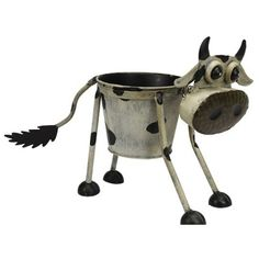 The Nodding Cow Planter is one of a range of three 'nodding' models, the other being a pig and a dog. The Nodding Cow is tall, and incorporates Animal Garden Ornaments, Cow Ornaments, Metal Planters, Flower Planters, Planter Pots, Succulent Pots, Watering Can, Metallic Paint, Hand Painted