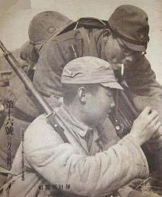 chinese collabotator giving cigarette to a japanese soldier (china 1939)