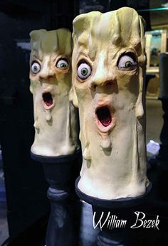 I am going to have to make funky candles for Halloween this year.  How funny are these?! <3