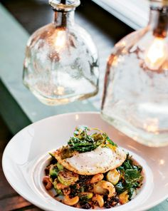 Voltaire: Witness the red and white quinoa biryani with jackfruit, tart cherries, toasted cashews and flash-fried spinach. Without the basted egg, the dish is a vegan's delight.
