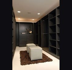 Suzie: Nicole Sassaman - Dark wood built-in shelves and cabinets!  Love walk-in closets! I want one!