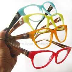 Colorful eyeglass frames for fair skinned hipsters. Vince Camuto Eyewear VO027. In Kiwi Green, Orange, Aqua Turquoise and Watermelon Red.